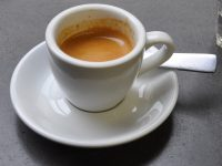 An espresso in a classic white cup made by Brooklyn Coffee using Caravan's Daily espresso blend.