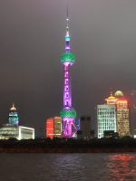 The futurist Oriental Pearl TV tower on the Pudong side of Huangpu River, as seen from the Bund at night.
