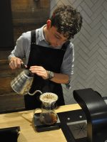 Barista in action, pouring a Kalita Wave filter at Origin's Euston Road branch.