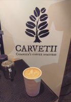 A flat white in my Therma Cup in front of the Carvetii logo at this year's Manchester Coffee Festival.