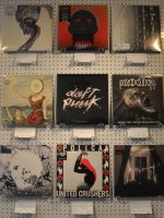 Some of the LPs for sale on the wall at Watford's The LP Cafe