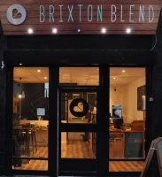 The front of Brixton Blend, with the downstairs clearly visible through the glass door and windows.