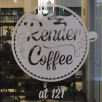 The Render Coffee Logo, a coffee cup seen from above, painted on the window at 121 Devonshire Street in Boston.