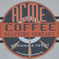 The Acme Coffee Roasting Company logo from the front of its coffee counter in Seaside, CA.