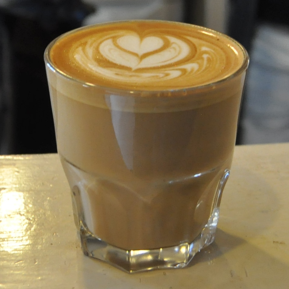 My flat white, in a glass, at Balance in Brixton.