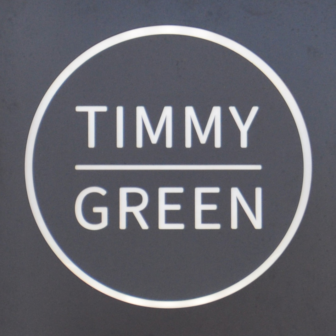 The Timmy Green logo from outside Timmy Green on Sir Simon Milton Square near Victoria Station.