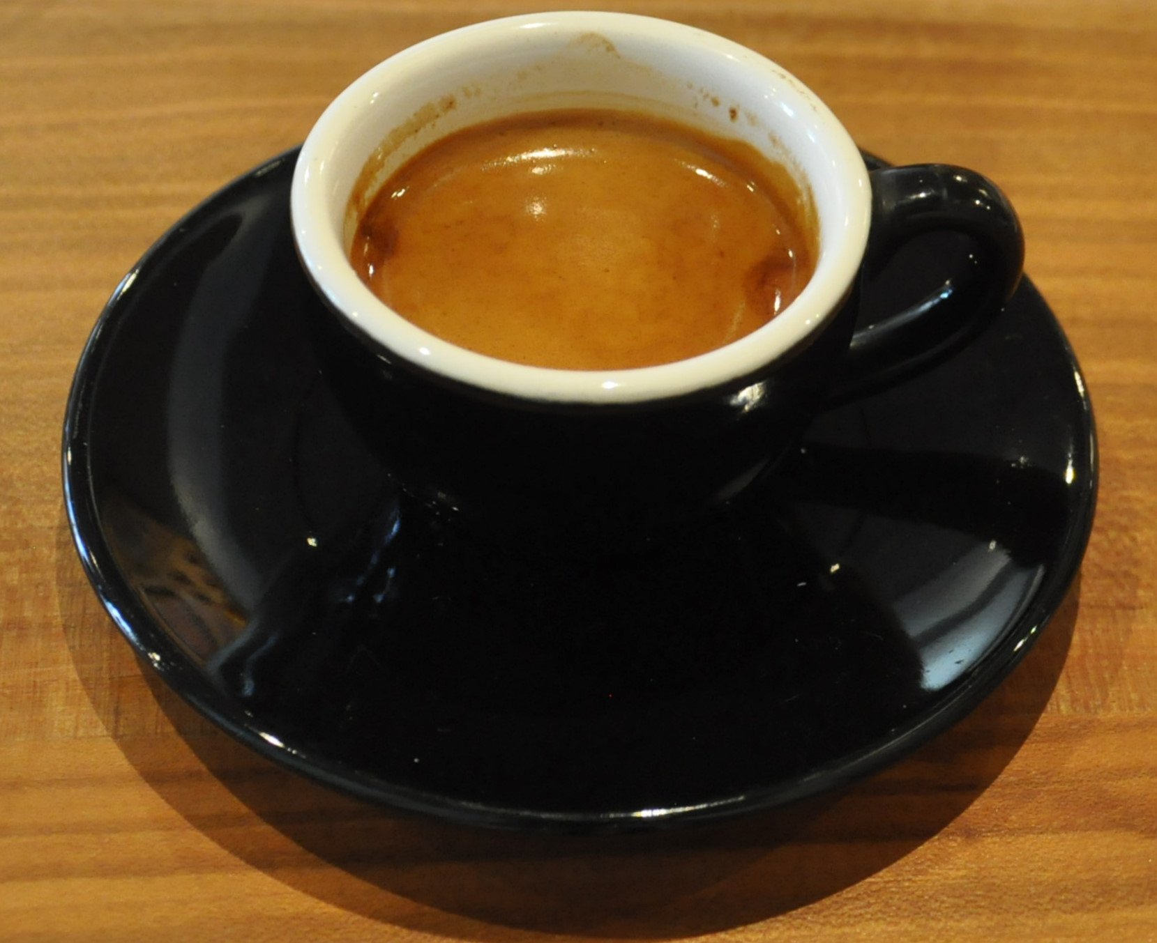 A single-origin Yirgacheffe from And Coffee Roasters, served in a classic black cup by Kaido Books & Coffee