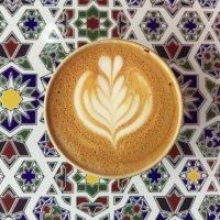 My flat white in my Ecoffee Cup on a lovely patterned tile at Lever & Bloom.