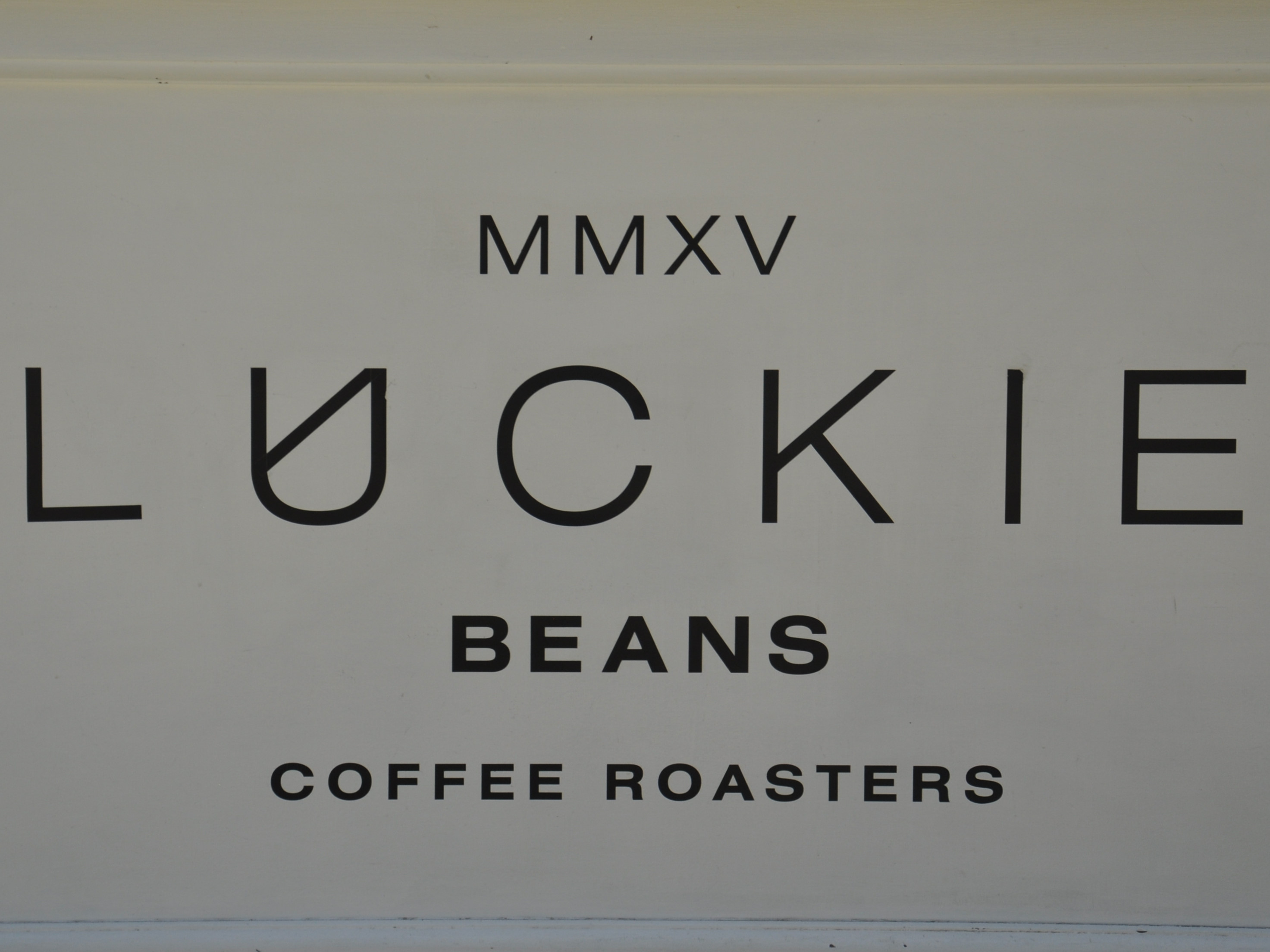 Detail from the front of the Luckie Beans coffee cart on the concourse of Glasgow's Queen Street Station.