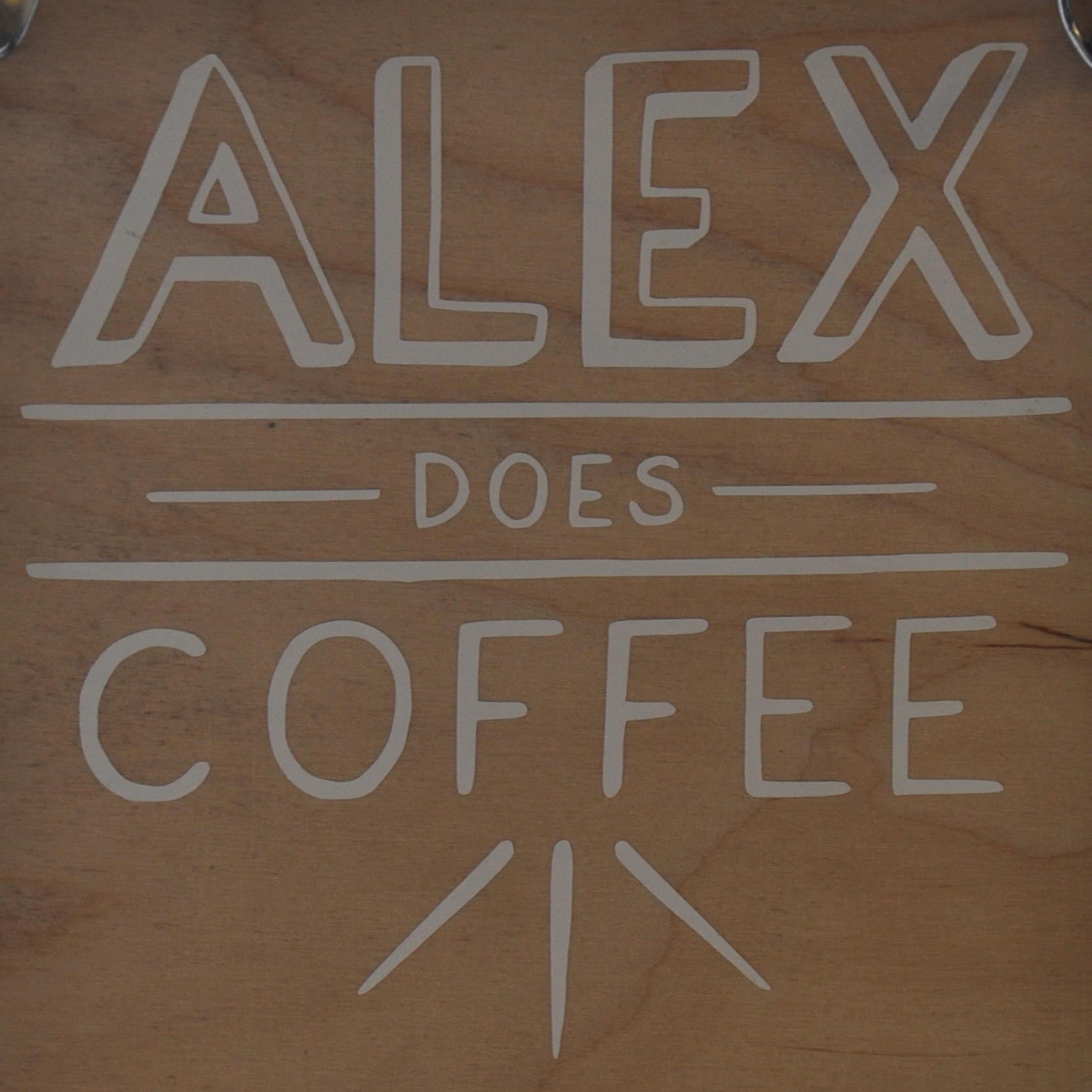 Details from the sign hanging on the door of Alex Does Coffee