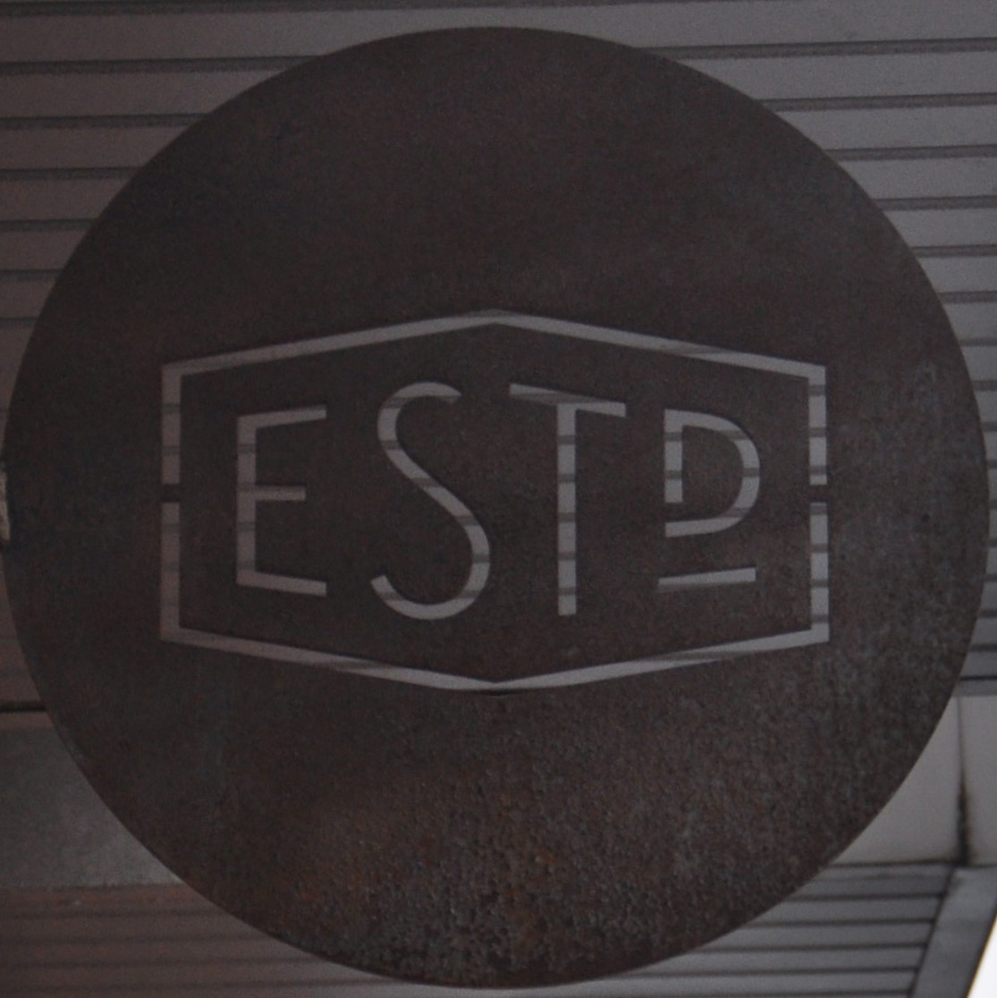 Detail from the sign outside Established Coffee in Belfast, showing the letters ESTD.