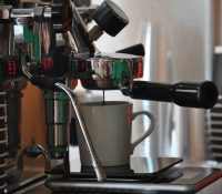 An espresso being pulled at Ritual Barbers in Madison using a bottomless portafilter.
