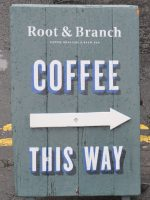 The Root & Branch sign, pointing the way to good coffee on Belfast's Jameson Street.