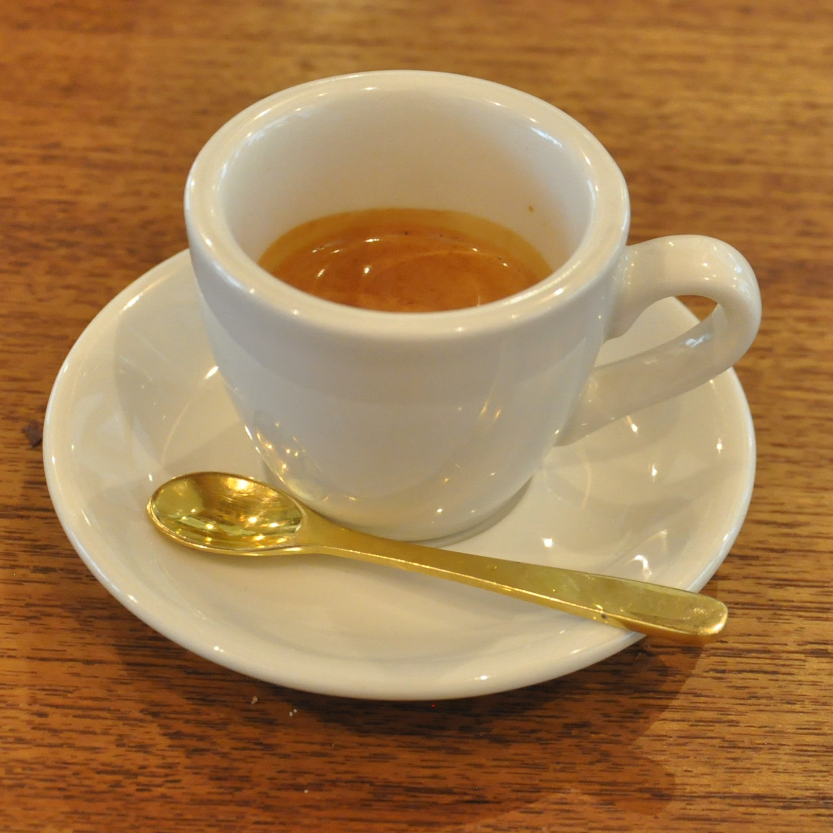 A lovely shot of the house-blend at Nem Espresso & Coffee in Tokyo, served in a classic white cup.