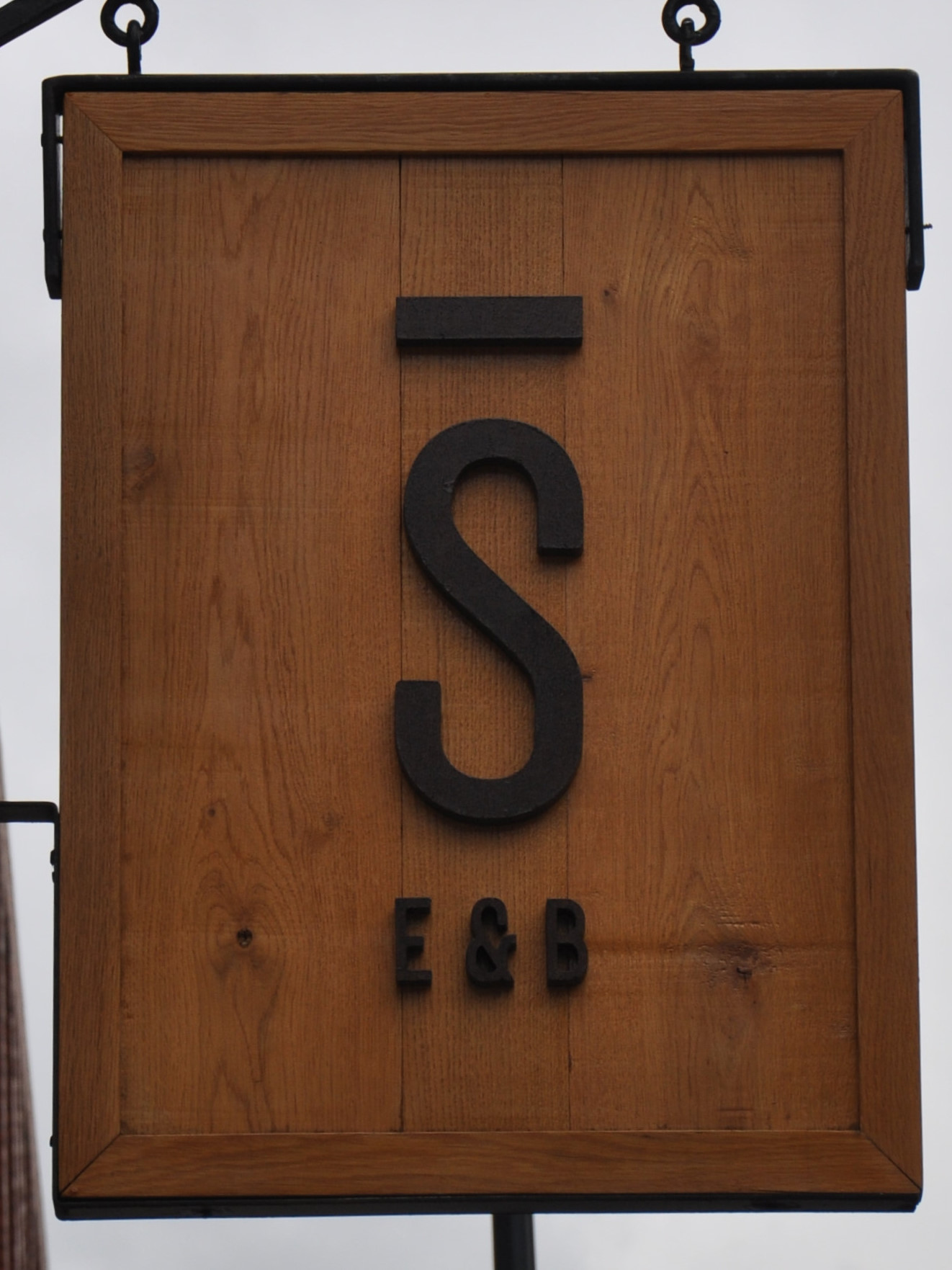 The minimalist sign for Stage Espresso and Brewbar, hanging outside on Oxford Row.