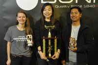The winners of this year's UK Cup Tasters Championship: Freda (centre), who successfully defended her title, Katelyn, who came second and Don, who finished third.