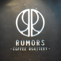 The Rumors Coffee Roastery logo from the front wall of the original Rumors in Shanghai