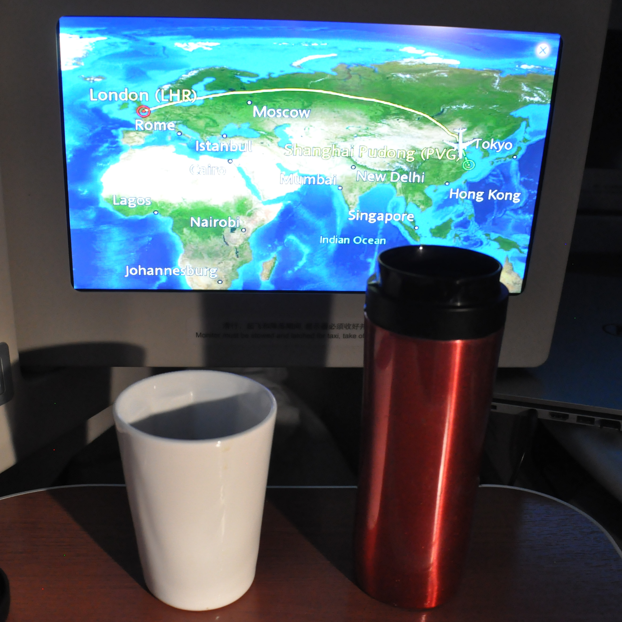 Celebrating a successful flight in business class with China Eastern to Shanghai with some coffee made in my Travel Press and served in my Therma Cup.