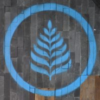The Lanna Coffee logo, in blue, on the wooden wall of the original Lanna Coffee Shop on Yuyuan Road.