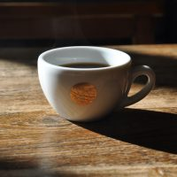 My filter coffee in an espresso cup in the sun at Beijing's Soloist Coffee Co. on Yangmeizhu Alley.