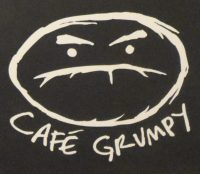 The Cafe Grumpy logo from the bottom of the menu on the wall of the Nolita branch.