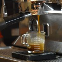 Watching espresso extract from my seat by the counter at Spitfire Coffee in New Orleans.