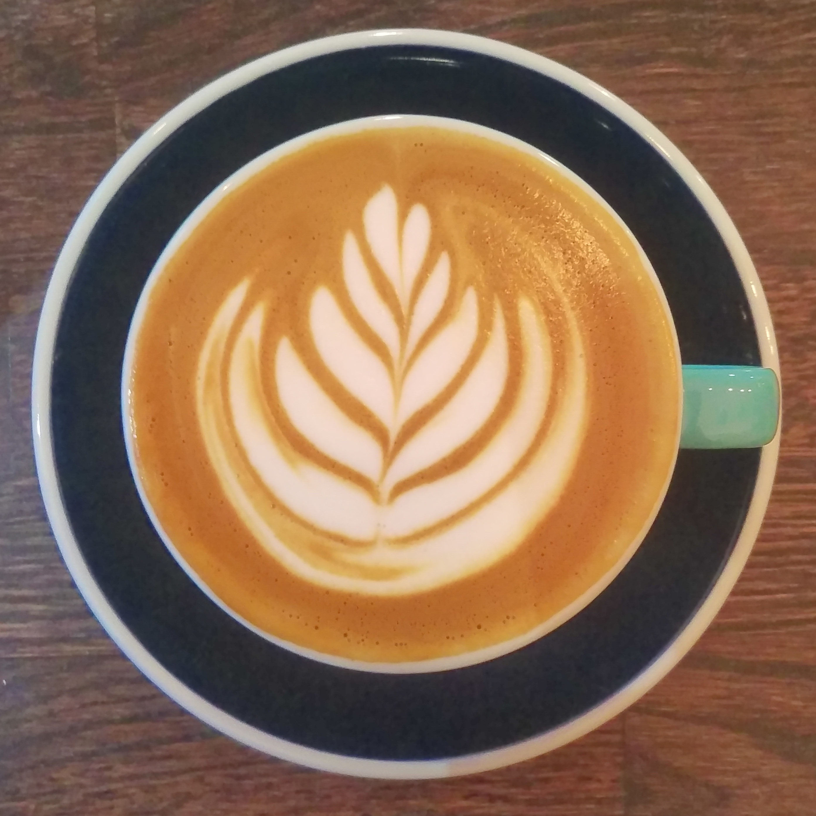Some lovely latte art in my flat white at Hunter Gatherer in Southsea.