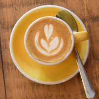 My piccolo, made with the guest espresso, served in a classic yellow espresso cup at Krema Coffee in Guildford.