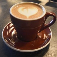 My 8oz latte in a classic tulip cup at The Roastery by Nozy.