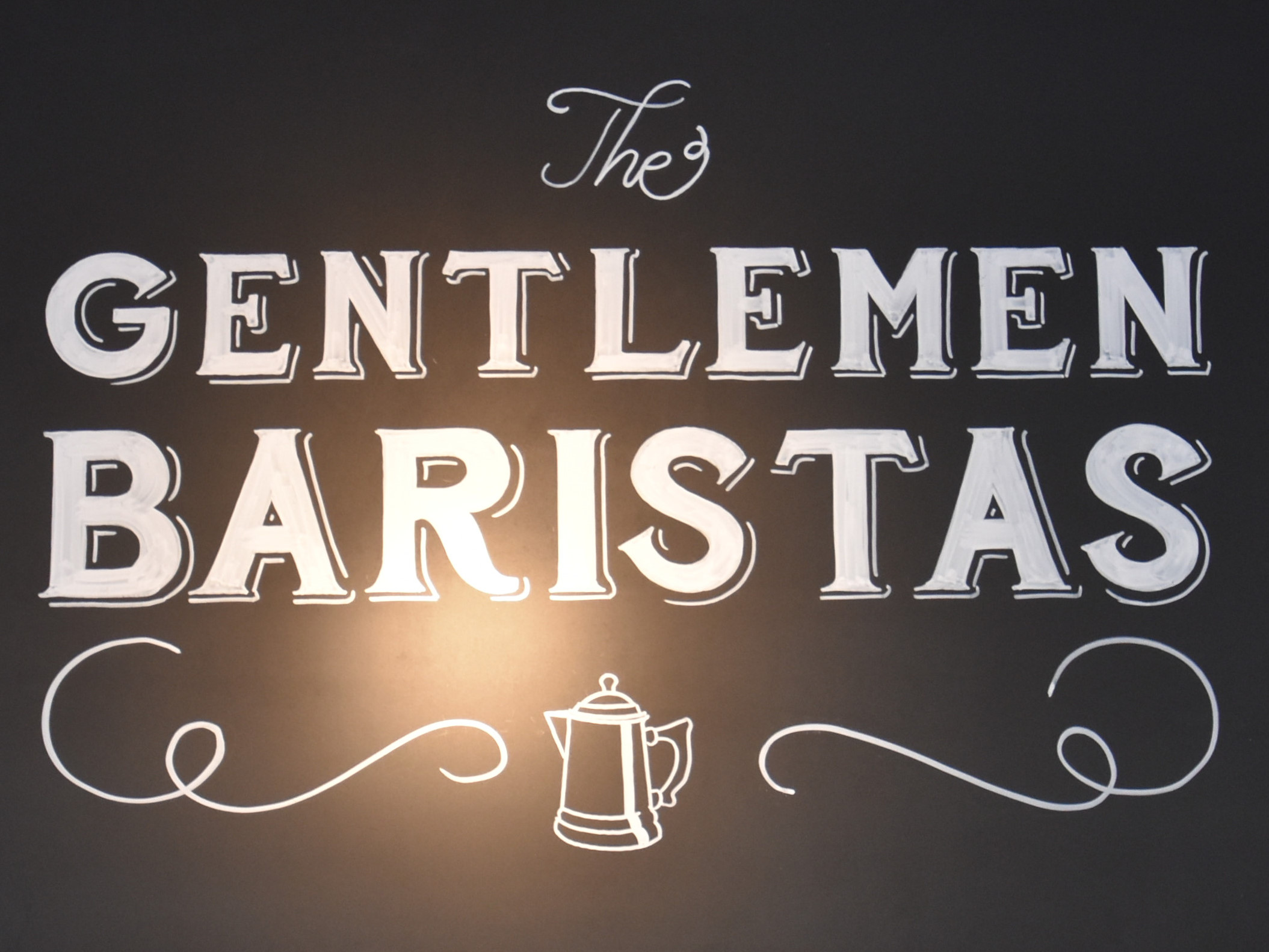 Detail of the sign hanging above the counter at The Gentlemen Baristas, The Coffee Store.