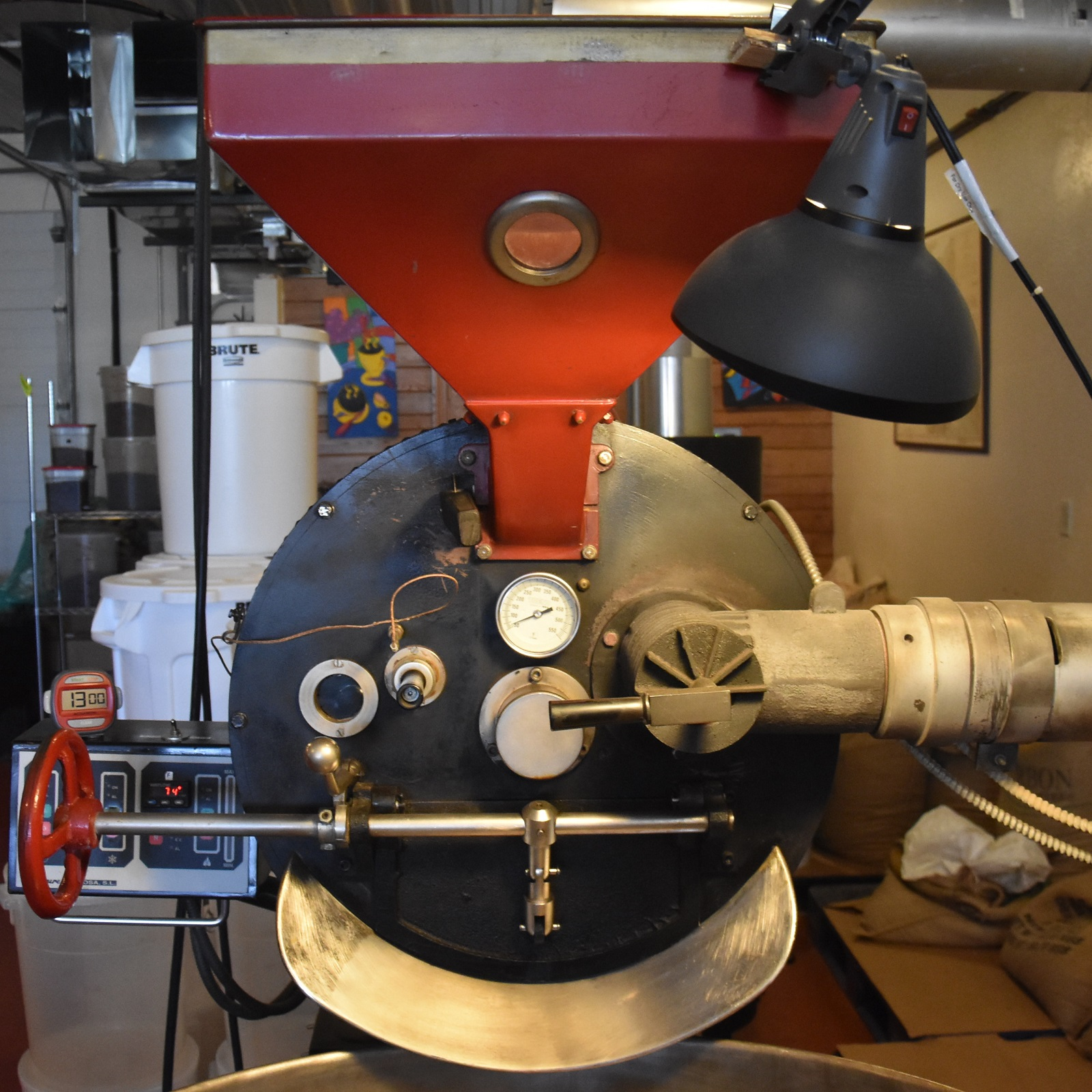 The red 15kg Toure roaster from Spain, the heart of the operation at Uncommon Grounds Specialty Roaster.