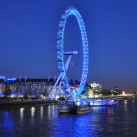 The London Eye, lit up at night in 2011, and seen from the Hungerford Bridge.