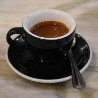 49th Parallel's Old School blend in a classic black espresso cup at Café Myriade - Dominion Square, Montréal