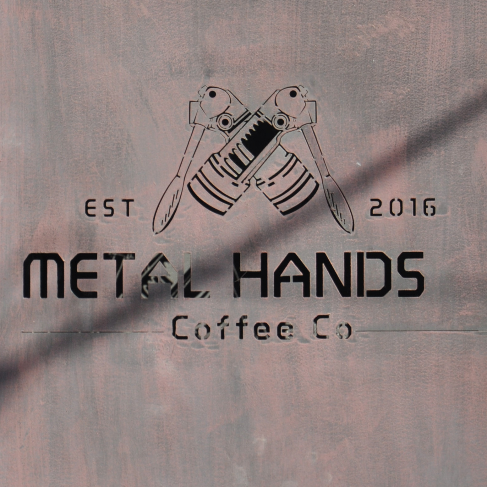 The Metal Hands Coffee Co logo from the wall outside Metal Hands in Beijing.