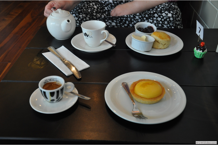A sumptuous spread on a previous visit. Lemon tart, scone, espresso and look! Tea!