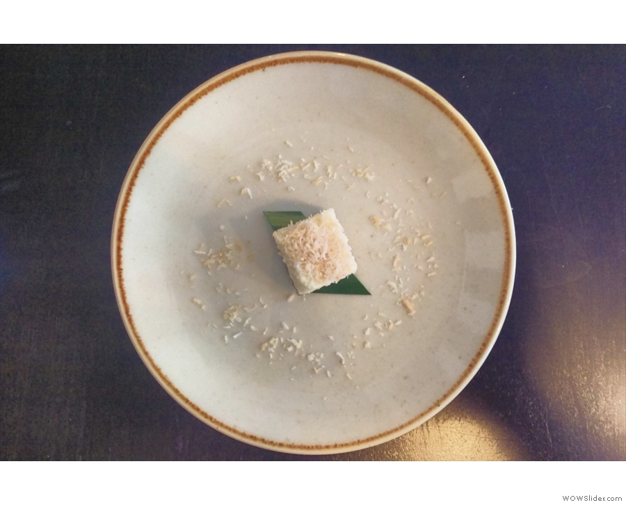 It's a very small, coconut-topped pandan cheesecake on a very big plate!
