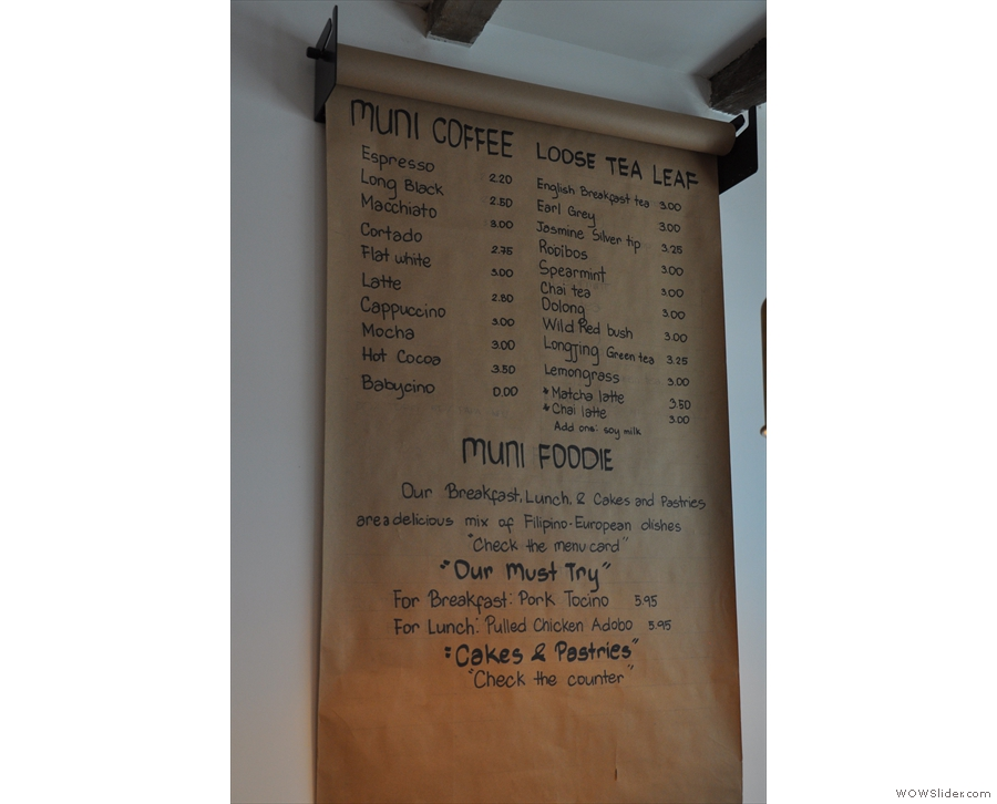 The menu is written up on brown paper behind the counter...