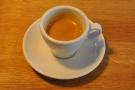 An espresso (not mine) in a classic white cup.