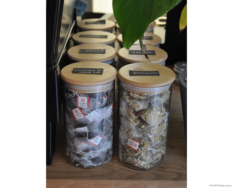 The tea bags, from Canton Tea, are kept in jars next to the espresso machine.