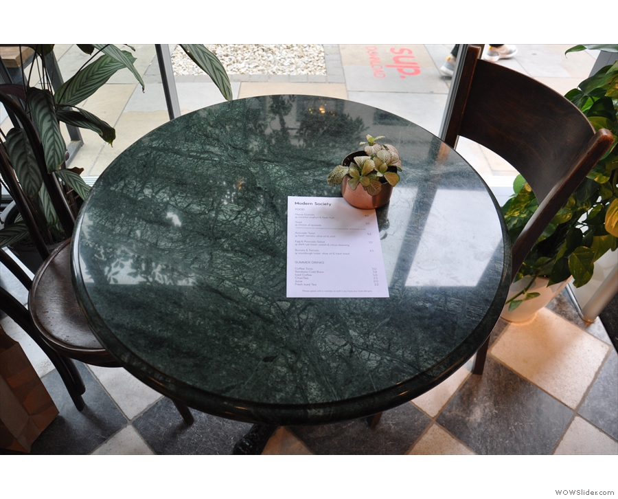 The food menus are scattered on the tables.