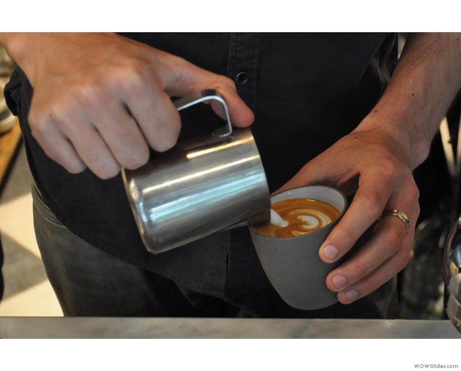 I love watching a latte artist at work.