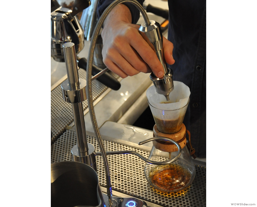 The first pour, to allow the coffee to bloom, is manual.