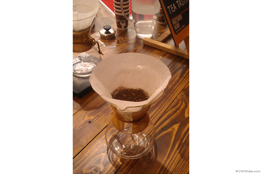While the Chemex filter paper is much thicker, the grind is similarly coarse for both of them. As before, a precise amount of ground coffee is weighed out and put into the pre-washed filter.