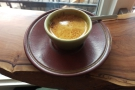 My espresso, in a lovely, earthenware, handleless cup.