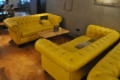 These large, comfy, yellow(!) sofas are on the left. There are two pairs of them...
