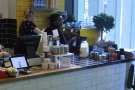 The bright-yellow espresso machine is in the window. There's the house-blend plus decaf.