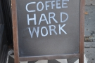 Enigmatic A-board, or a simple statement of the barista's life?