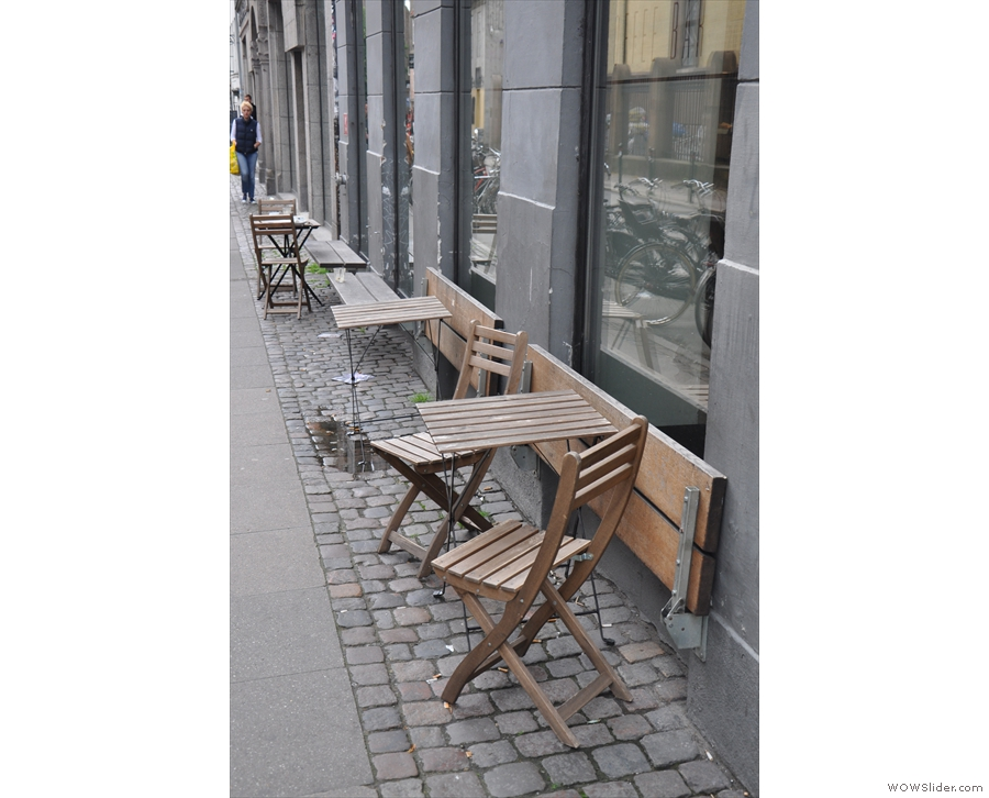There's outside seating, with table for each window...