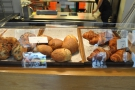 ... as well as bread rolls and more pastries, all made in the kitchen behind the counter.
