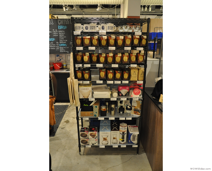 To the right of the counter is a large retail shelf unit, packed with goodies.